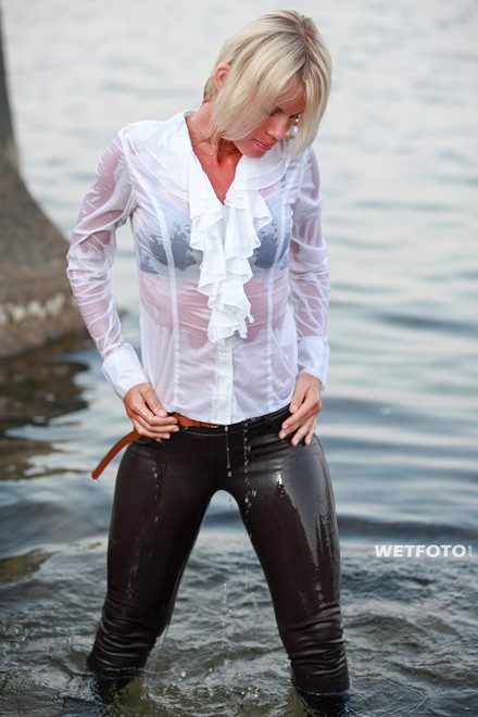 wet woman get wet fully clothed blouse leggings shoes sea
