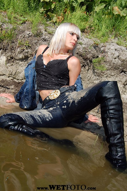 wet girl get wet wet hair fully clothed jacket denim jeans boots lake