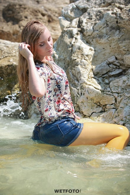 wet girl wet hair get wet swimming fully clothed blouse  denim shorts stockings shoes high heels sea