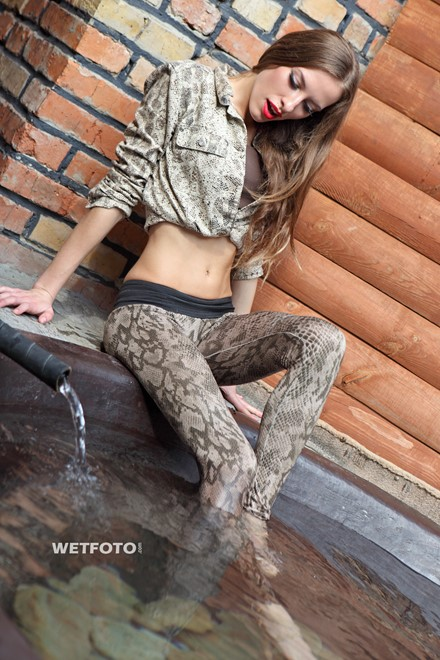 wet girl get wet jacket leggings high heels vat