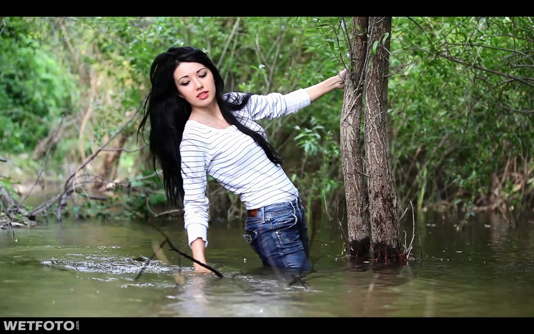 wet girl brunette wet hair get wet swimming fully clothed tight jeans sweater tights shoes high heels river