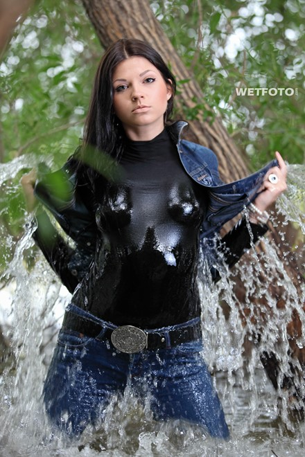 wet girl brunette get wet fully clothed skinny jeans jacket denim tights leather boots heels lake