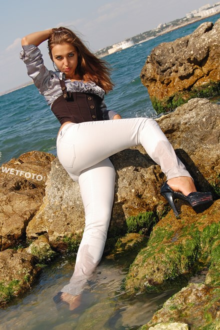 wet girl brunette wet hair get wet soaked swimming fully clothed white jeans blouse heels clothes sea