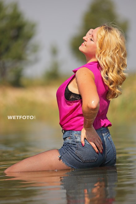 wet girl get wet blouse denim shorts tights high heels swim fully clothed lake