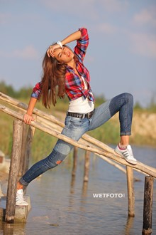 #273 - Wetlook by Pretty Girl in Shirt, Tight Jeans and White Sneakers on Lake