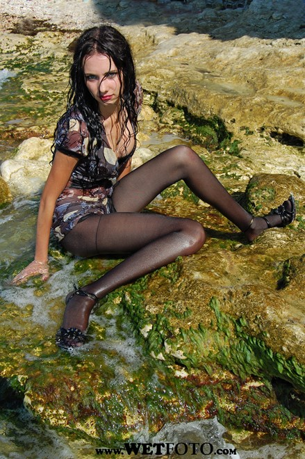 wet girl get wet wet hair fully clothed dress stockings high heels sandals sea waves