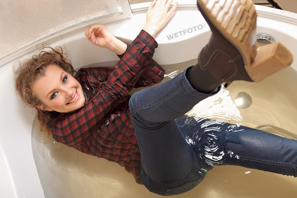 wet girl get wet wet hair jeans shirt boots bath