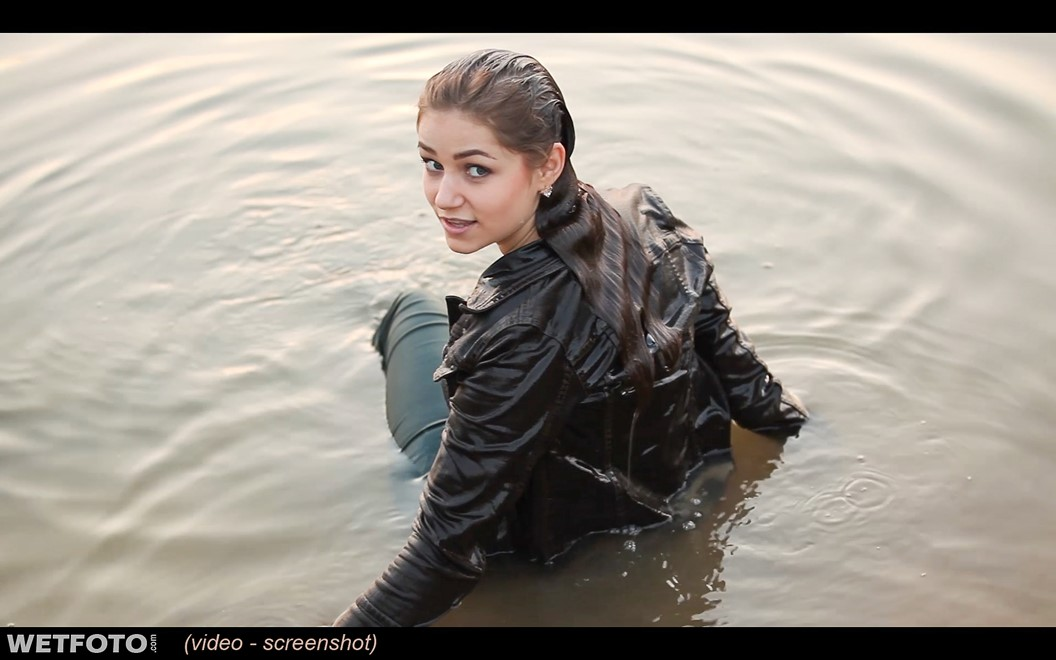 wet girl get wet swim fully clothed wet hair jacket tight jeans boots lake