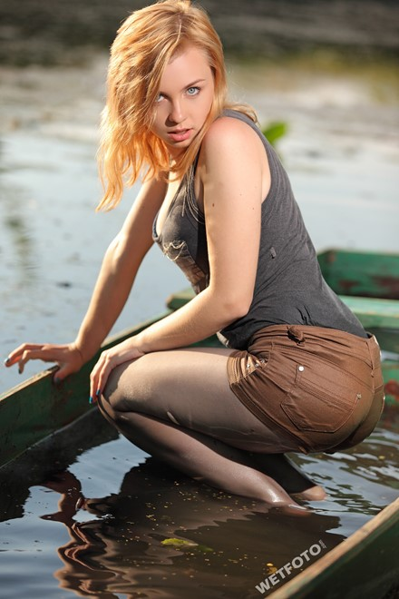 wet girl get wet swim fully clothed wet hair jacket shorts tights high heels lake