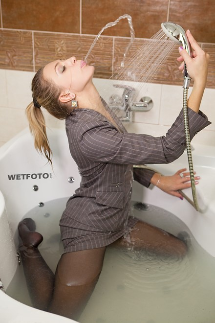 wet girl wet hair get wet business suit skirt tights hand bag high heels fully clothed fully soaked bath
