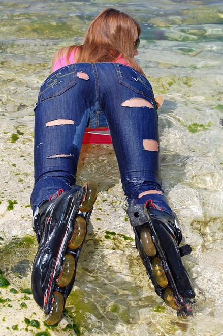 #32 - Wetlook by Sport Girl in Jeans, T-Shirt and Roller-Skates by the Sea