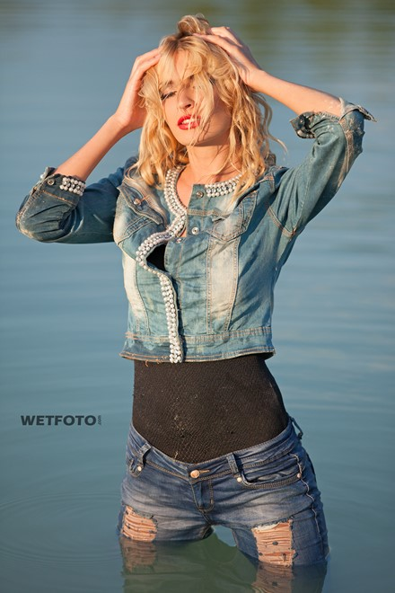 wet girl wet hair get wet denim jacket tight jeans swimsuit swim fully clothed fully soaked lake