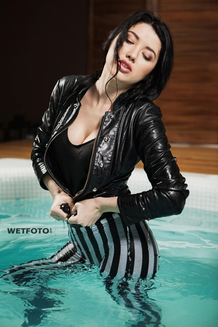 wet girl wet hair get wet top leather jacket leggings high heels fully soaked swim fully clothed pool