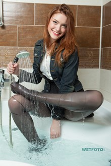 #328 - Wet Girl in Transparent Blouse, Mini Skirt and Tights Enjoy Her Wetlook
