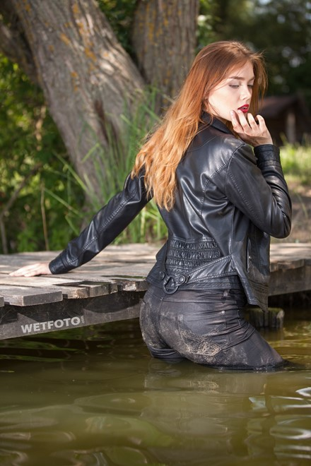 wet girl get wet fully clothed clothes leather jacket leggings tights t-shirt boots high heels lake