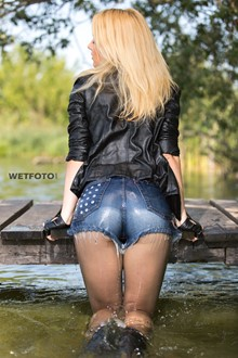 #338 - Wetlook by Sexy Woman in Leather Jacket, Denim Shirt, Short Shorts and High Heels