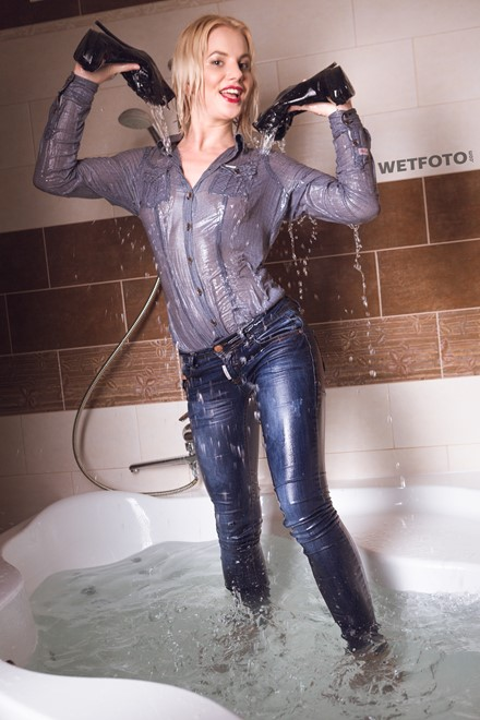 wet girl fully clothed wet get wet soaking wet vest denim shirt jeans high heels jacuzzi