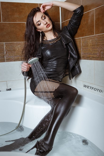 wet girl fully clothed wet get wet soaking wet leather dress jacket tights high heels jacuzzi