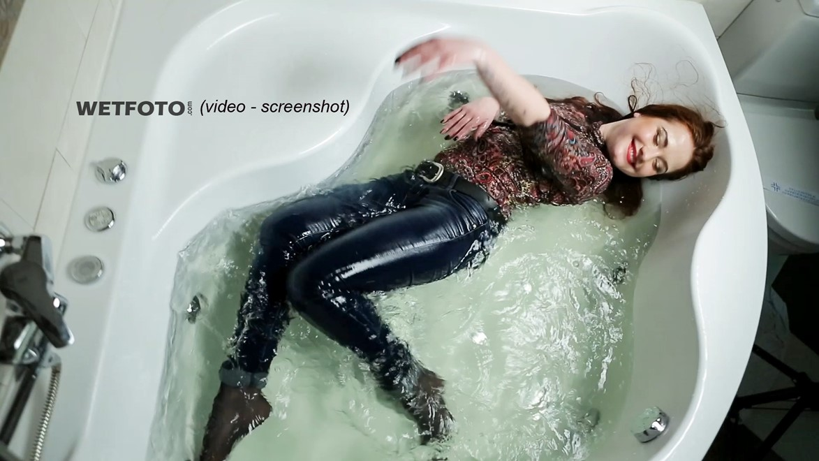 wet girl fully clothed wet get wet soaking wet colorful golf jeans boots jacuzzi