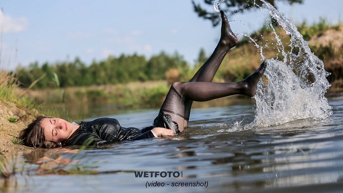 wet girl wet hair get wet soaked swimming fully clothed blouse leather suit jacket skirt tights river