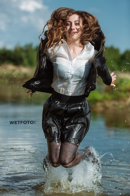wetfoto wet fully clothed girl in the lake