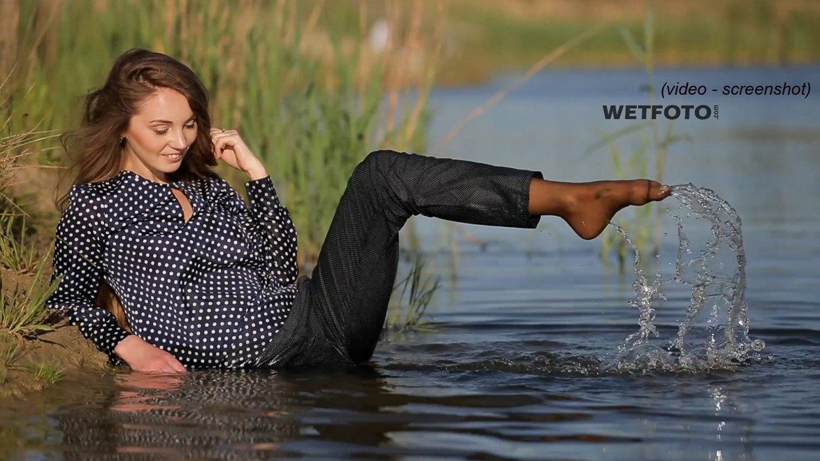 wet girl wet hair get wet swimming fully clothed blouse tight pants tights lake mud