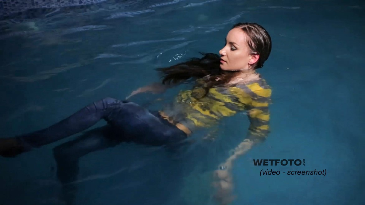 wet girl get wet swimming fully clothed tights sweater tight jeans high heels pool shower