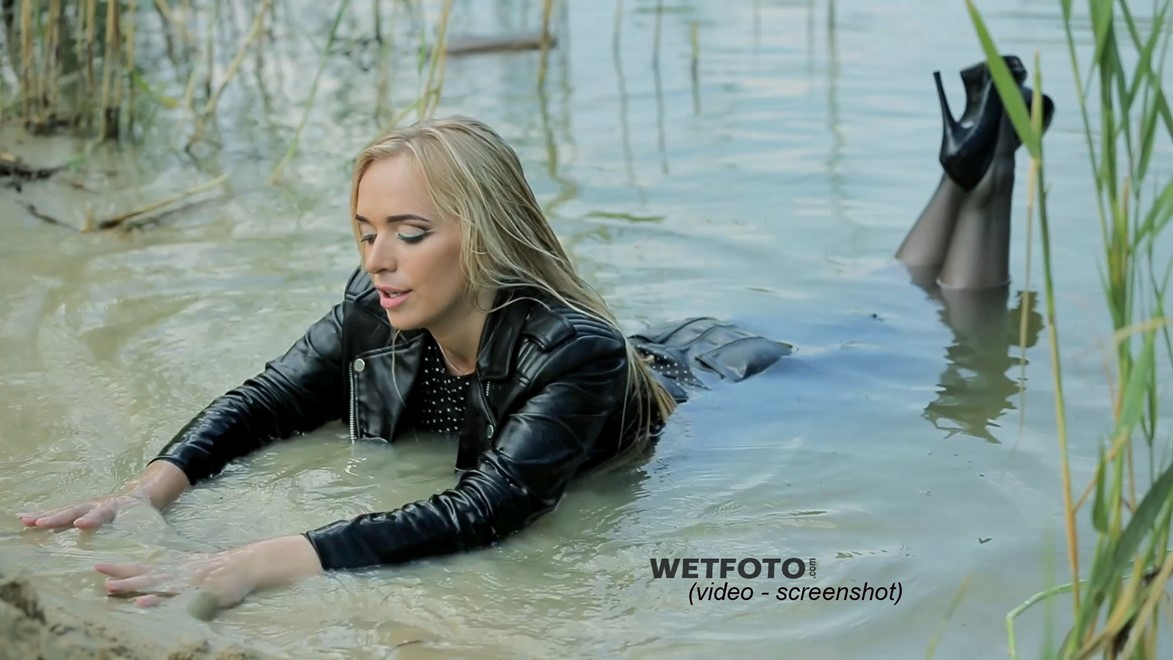 wet girl soaked get wet swimming fully clothed tights leather jacket skirt high heels lake
