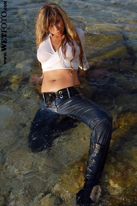 wet woman get wet wet hair fully clothed blouse tight jeans leather boots high heels