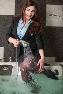 #373 - Wetlook by Pretty Girl in Business Suit, Blouse and Stockings in Jacuzzi Bath