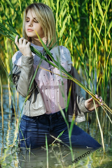 blonde wet girl swim fully clohed wet hair blouse skinny jeans jacket high heels lake