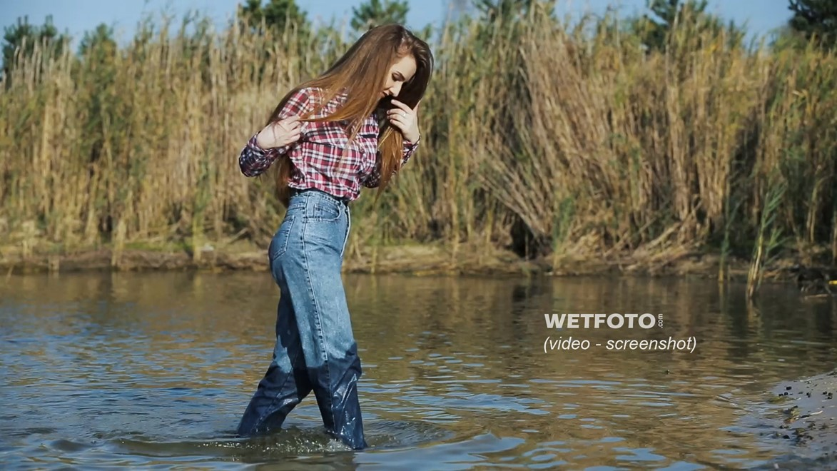 wet girl long haired swim fully clothed water wet clothes jeans shirt tights shoes wet hair lake
