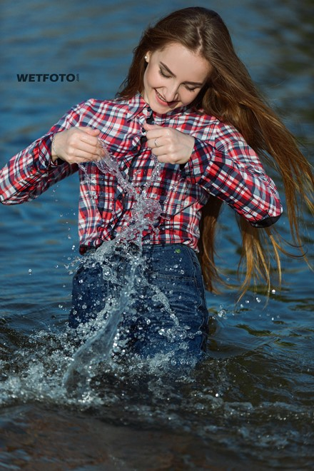 wetlook long haired girl swims posing water wet clothes on high waisted jeans shirt pantyhose wetfoto