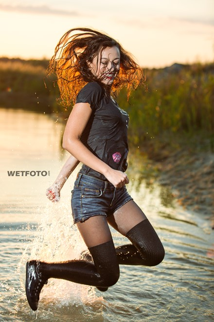 wet girl get wet water t-shirt denim shorts stockings sneakers wet hair soaked