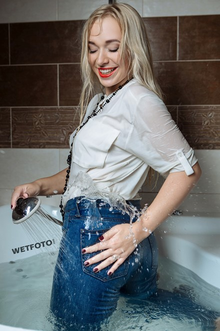 wet girl get wet blonde soaked fully clothed socks blouset jeans shower high heels shoes