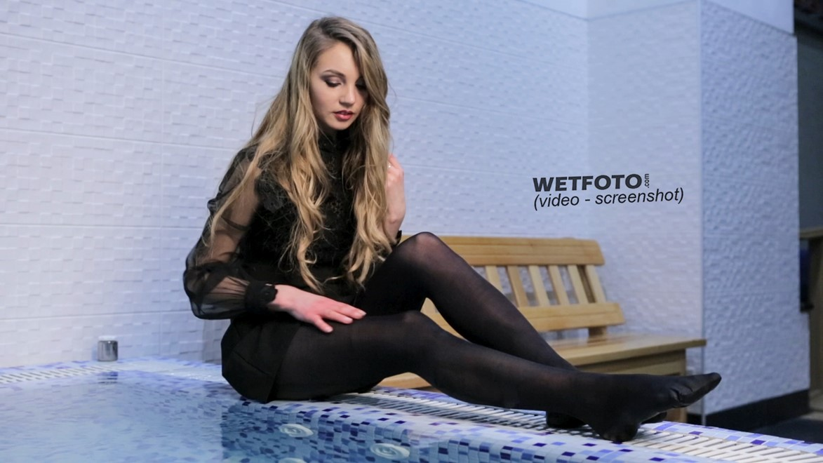 wet girl fully clothed get wet dress stockings water jacuzzi pool