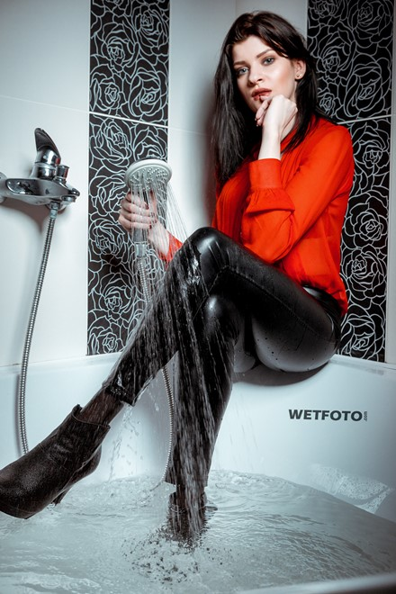 wetlook girl get wet fully clothed bathroom takes shower shiny faux leather pants