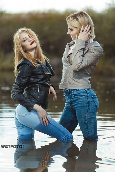 wet girl fully clothed blouse jacket jeans tights water lake