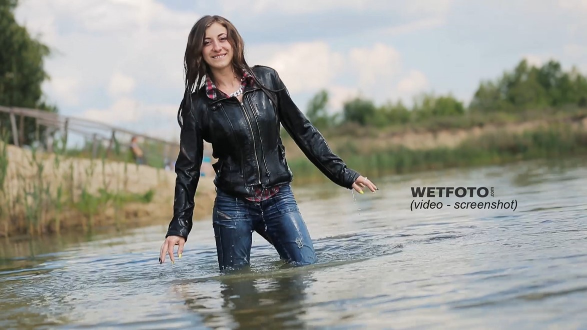wet girl get wet jacket jeans leather shirt shoes high heels tights fully clothed water swim lake