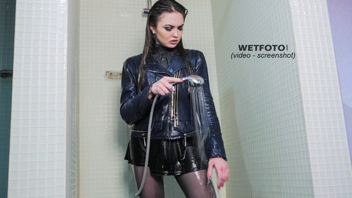 wet girl get wet golf skirt leather jacket stockings boots high heels fully clothed wet hair pool jacuzzi