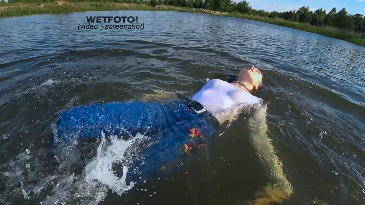 wet girl get wet blouse jeans socks jacket fully clothed wet hair swimming lake water