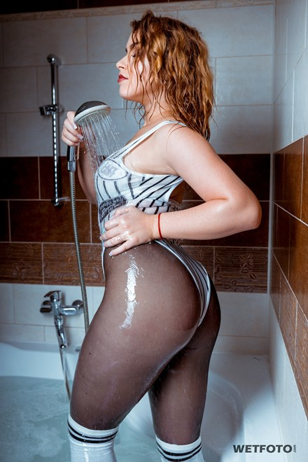 store wetfoto wetlook girl denim shorts tights get soaking wet jacuzzi bath