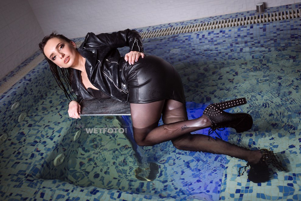wetfoto girl gets soaking wet faux leather dress pantyhose pool