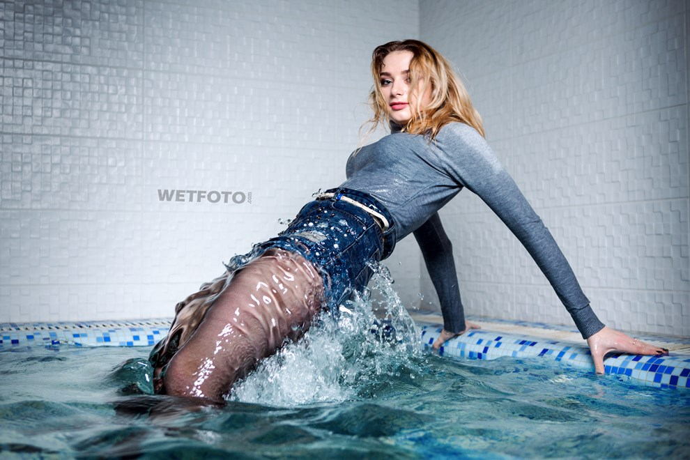 wetfoto swimming fully clothed wetlook model in pool underwater