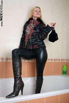 #45 - Soaking Wet Woman in Jacket, Leggings and Leather Boots in Bath