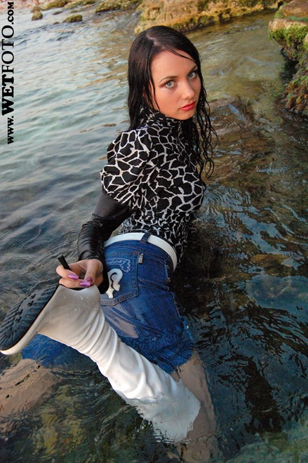 wet girl get wet wet hair swim fully clothed blouse denim shorts boots leather sea