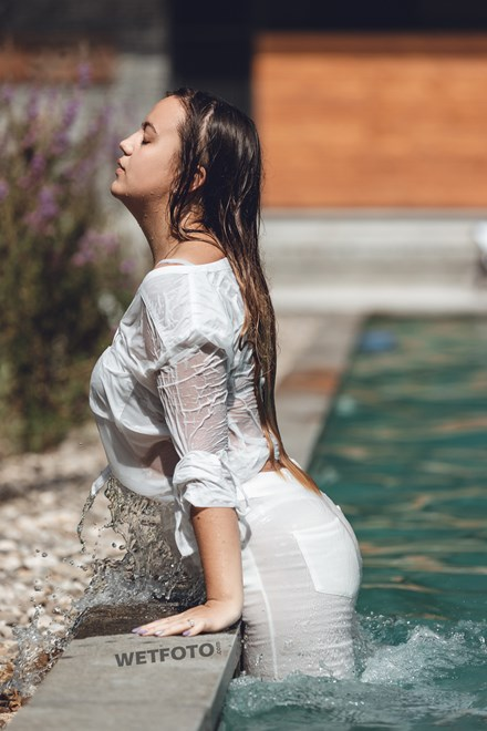 wetfoto fully clothed wetlook girl white jeans completely wet pool