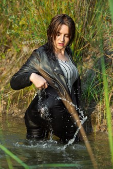 #471 - Active Wetlook with Young Girl Dressed in Jeans, Blouse and Leather Jacket