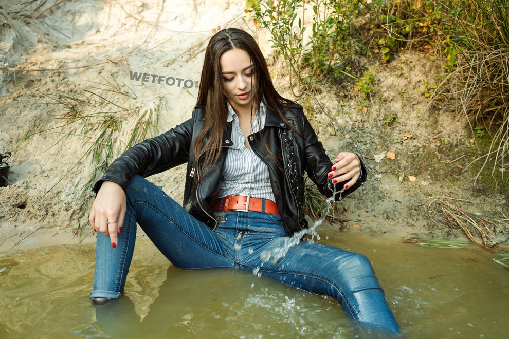 wetfoto girl fully clothed get wet swim blue jeans