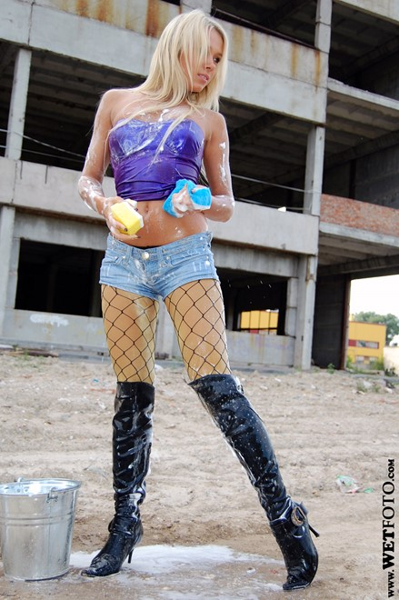 wet girl get wet fully clothed top denim shorts stockings boots leather